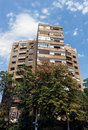 Perspective of Bucharest flat block with trees and blue sky Royalty Free Stock Photo