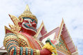 Perspective of Giant with white temple on sky background