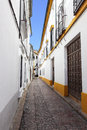 Perspective of old narrow street in cordoba spain Stock Photography