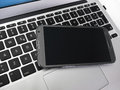 Phablet on laptop Royalty Free Stock Photo