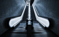 Perspective of two empty escalators with illuminated sides Stock Photography