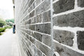 Perspective view of brick wall at park. Royalty Free Stock Photo