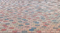 Perspective View of Colorful Brick Stone Street Road. Sidewalk, Pavement Texture Background Royalty Free Stock Photo