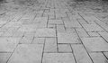 Perspective View of Monotone Grunge Cracked Gray Brick Marble Stone on The Ground for Street Road. Sidewalk, Driveway, Pavers Royalty Free Stock Photo