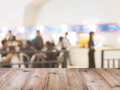 Perspective wood and blurred food court with crowd people. Royalty Free Stock Photo