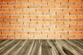 Perspective wood plank floor or walk way with old brick wall Royalty Free Stock Photo