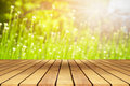 Perspective wooden table on top over blur natural background, ca