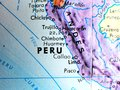 stock image of  Peru focus macro shot on globe map for travel blogs, social media, website banners and backgrounds.