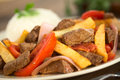 Peruvan dish called lomo saltado peruvian made of beef tomato red onion and french fries served with rice selective focus focus Royalty Free Stock Image