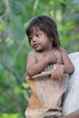 Peruvian child little girl member of jungle tribe in amazon Royalty Free Stock Photography