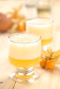 Peruvian cocktail called aguaymanto physalis sour prepared from juice pisco grape hard liquor syrup and egg Stock Photography