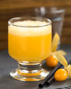 Peruvian cocktail called aguaymanto physalis sour prepared from juice pisco grape hard liquor syrup and egg Royalty Free Stock Images