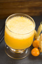 Peruvian cocktail called aguaymanto physalis sour prepared from juice pisco grape hard liquor syrup and egg Royalty Free Stock Photo