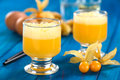 Peruvian cocktail called aguaymanto physalis sour prepared from juice pisco grape hard liquor syrup and egg Stock Image