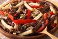 Peruvian cuisine lomo saltado macro on a plate horizontal rustic Stock Images