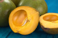 Peruvian fruit called lucuma lat pouteria which has a dry sweet flesh and is mostly used to prepare juices milkshakes Stock Photography