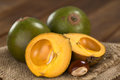 Peruvian fruit called lucuma lat pouteria which has a dry sweet flesh and is mostly used to prepare juices milkshakes Royalty Free Stock Images