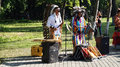 Peruvian Indians musicians singing  in the park Royalty Free Stock Photo