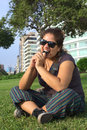 Peruvian Woman Bitin on Mobile Phone Royalty Free Stock Photos