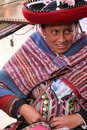 Peruvian woman weaving a blanket with alpaca wool Royalty Free Stock Photography