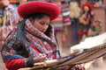 Peruvian woman weaving a blanket out of alpaca wool Royalty Free Stock Image