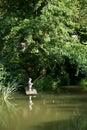 Pesca de little boy del borde del muelle de madera Imagen de archivo libre de regalías