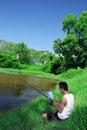 Pesca, relajándose en naturaleza Fotos de archivo