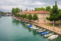 Peschiera del garda in italy and small boats in mincio river Royalty Free Stock Images