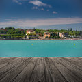 Peschiera del garda on lake in italy with wooden floor Royalty Free Stock Images