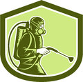 Pest control exterminator spraying shield retro illustration of side view set inside crest on isolated background done in style Royalty Free Stock Photo