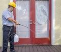 Pest control worker spraying a pesticides Stock Photos