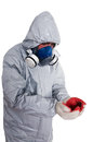 Pest control worker a wearing a mask hood protective suit and dual air filters holding Royalty Free Stock Photos