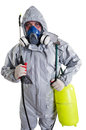 Pest control worker a wearing a mask hood protective suit and dual air filters holding a hose to help exterminate rats and other Royalty Free Stock Photo
