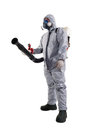 A pest control worker wearing mask hood protective suit and dual air filters holding hose to help exterminate rats and other Royalty Free Stock Photo