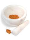 Pestle and mortar on white background with mixed spices in the Royalty Free Stock Photos