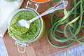 Pesto and garlic scapes jar of with Royalty Free Stock Photos