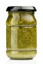 Pesto jar with sauce on the white background Royalty Free Stock Image