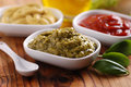 Pesto and other sauces in white bowls Royalty Free Stock Image