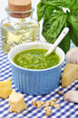 Pesto sauce ceramic bowl with fresh made on blue checkered background Royalty Free Stock Image