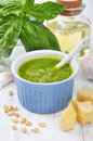 Pesto sauce ceramic bowl with fresh made on wooden background Stock Photos