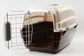 Pet carrier opened travel plastic on white Royalty Free Stock Photos