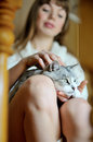Pet cat on the knees of girl Stock Photo