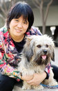 Pet dog with its owner cute outdoor portrait,it is an adopted stray dog。 Stock Photos