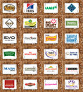 Pet food brands and logos collection of of famous companies on white tablet on rusty wooden background like nutro hills Royalty Free Stock Images