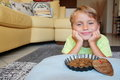 Pet perspective: join a smiling thoughtful kid with a food bowl Royalty Free Stock Photo