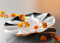 Petal on plate orange silver Royalty Free Stock Image