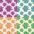 Petals of flowers set of 4 colored vector seamless geometric patterns on the background Royalty Free Stock Photo