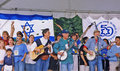 "Pete seeger legendary folk singer and troubadour leads the singing of ""tzena tzena tzena "" a song originated by israeli Royalty Free Stock Photo"