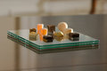 Petit fours on a modern glass plate Stock Photo