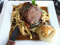 Petite filet mignon on a bed of homemage pasta with mushrooms and truffle oil shallow depth of field Stock Images